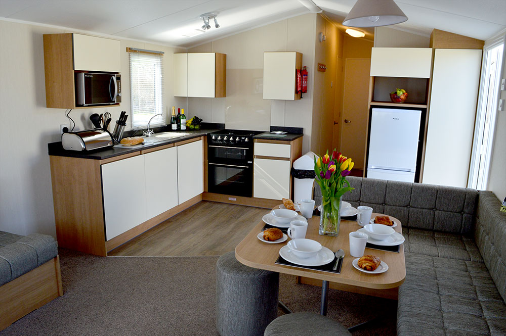 Living area in one of our Gold caravans with hot tub.