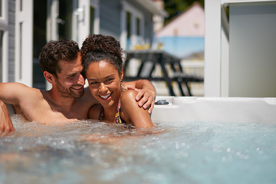 A photo showing a couple in a hot tub as inspiration for UK staycation ideas.
