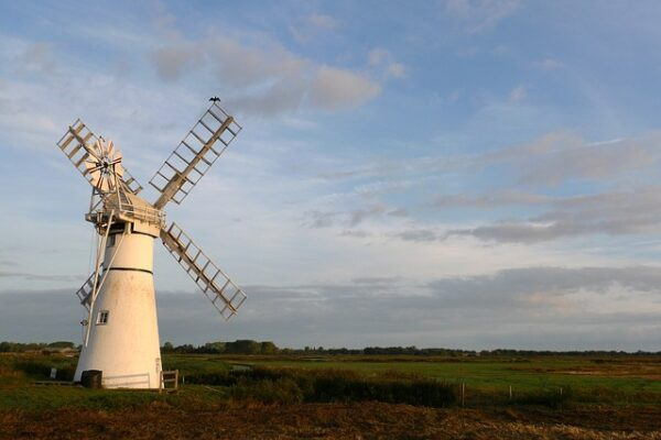 A photograph showing a Windmill in the Broads National Park.