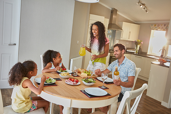 Family enjoying breakfast in one of our Platinum Lodges with hot tub.